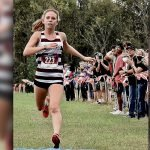 Evans wins region XC meet; Wildcats, Canes post top-3 finishes